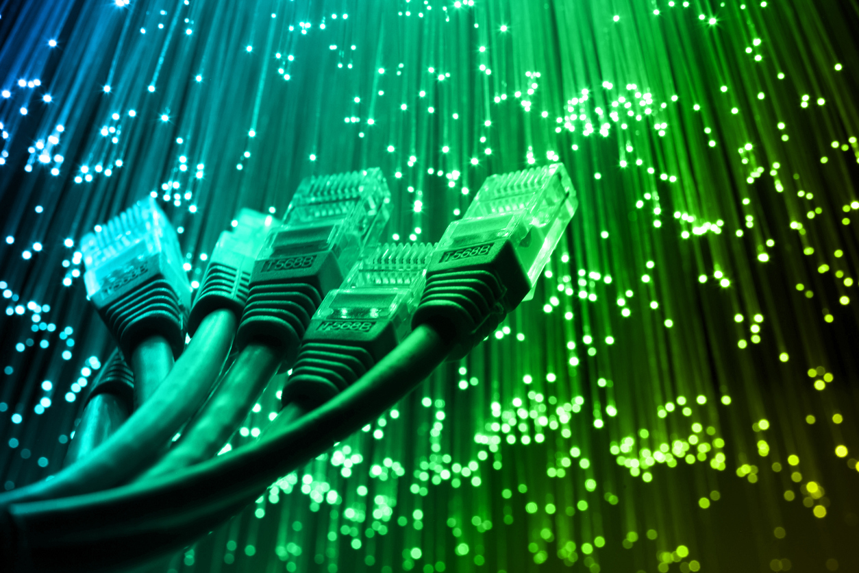 Network cable with Fiber optics light internet concept